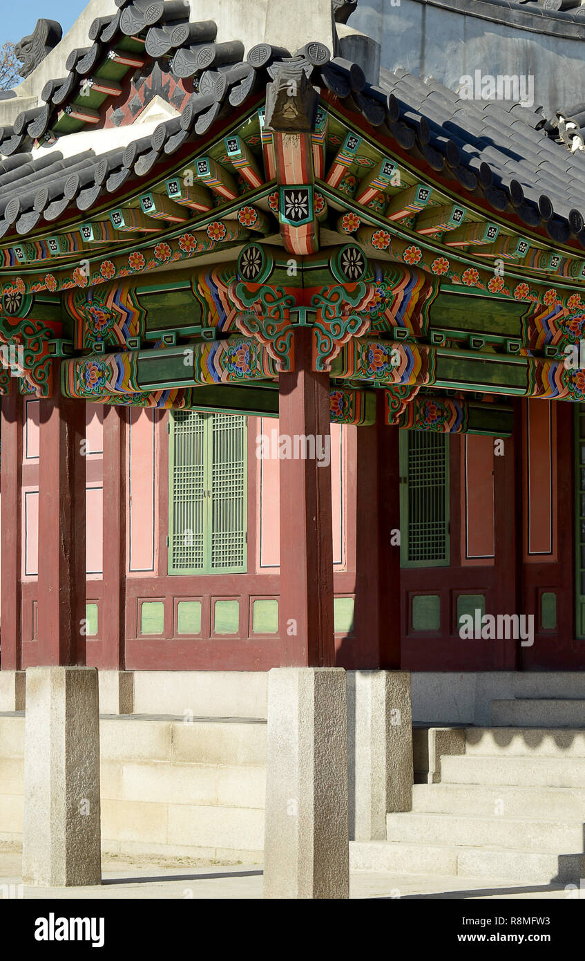 Hipped roofs, tiles, and painted decorations on the roof, typical Korean palatial architecture at Changdeokgung palace, Seoul. Korea - Stock Image