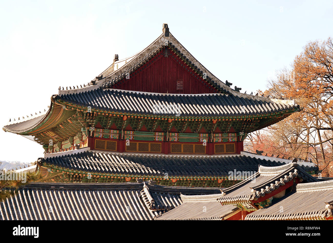 Hipped roofs, tiles, painted decorations, and hermits, monks and monsters on the roof as guardians, Korean palatial architecture at Changdeokgung - Stock Image