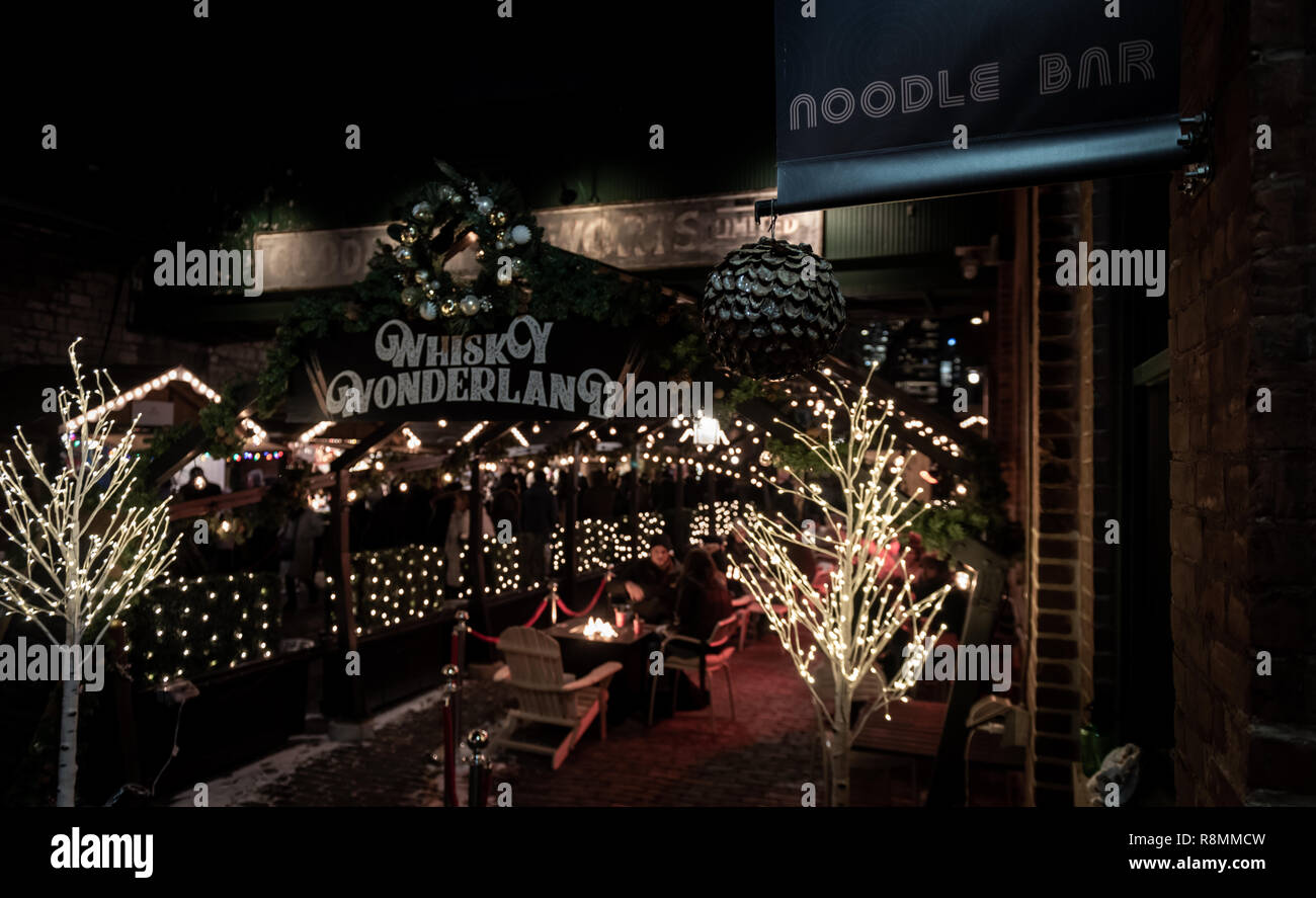 An evening stroll through the Distillery District at the Toronto Christmas Market 2018. Stock Photo