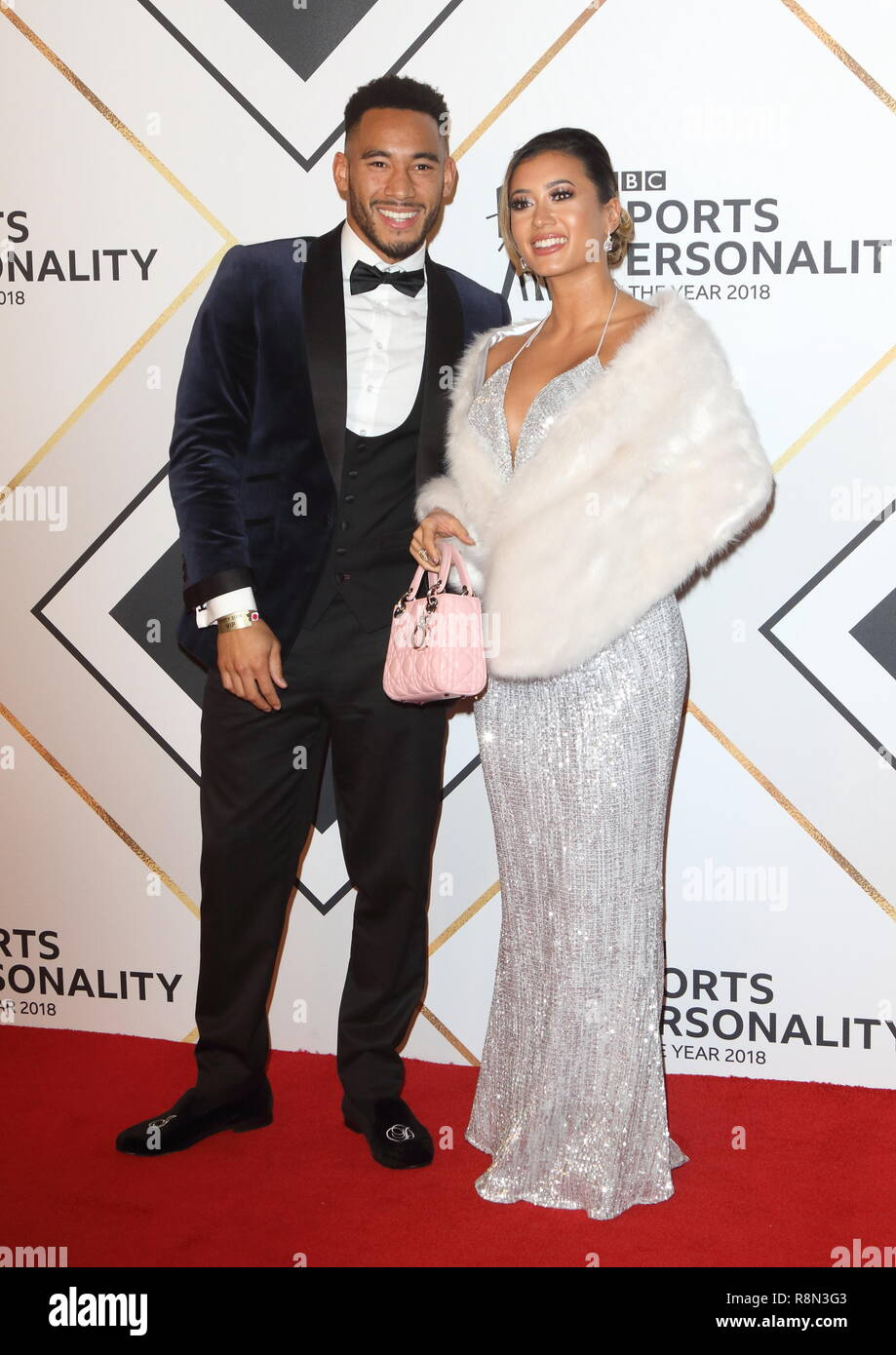 Josh Denzel and Kaz Crossley on the red carpet at the BBC Sports Personality Of The Year 2018 at the Resorts World Arena. - Stock Image