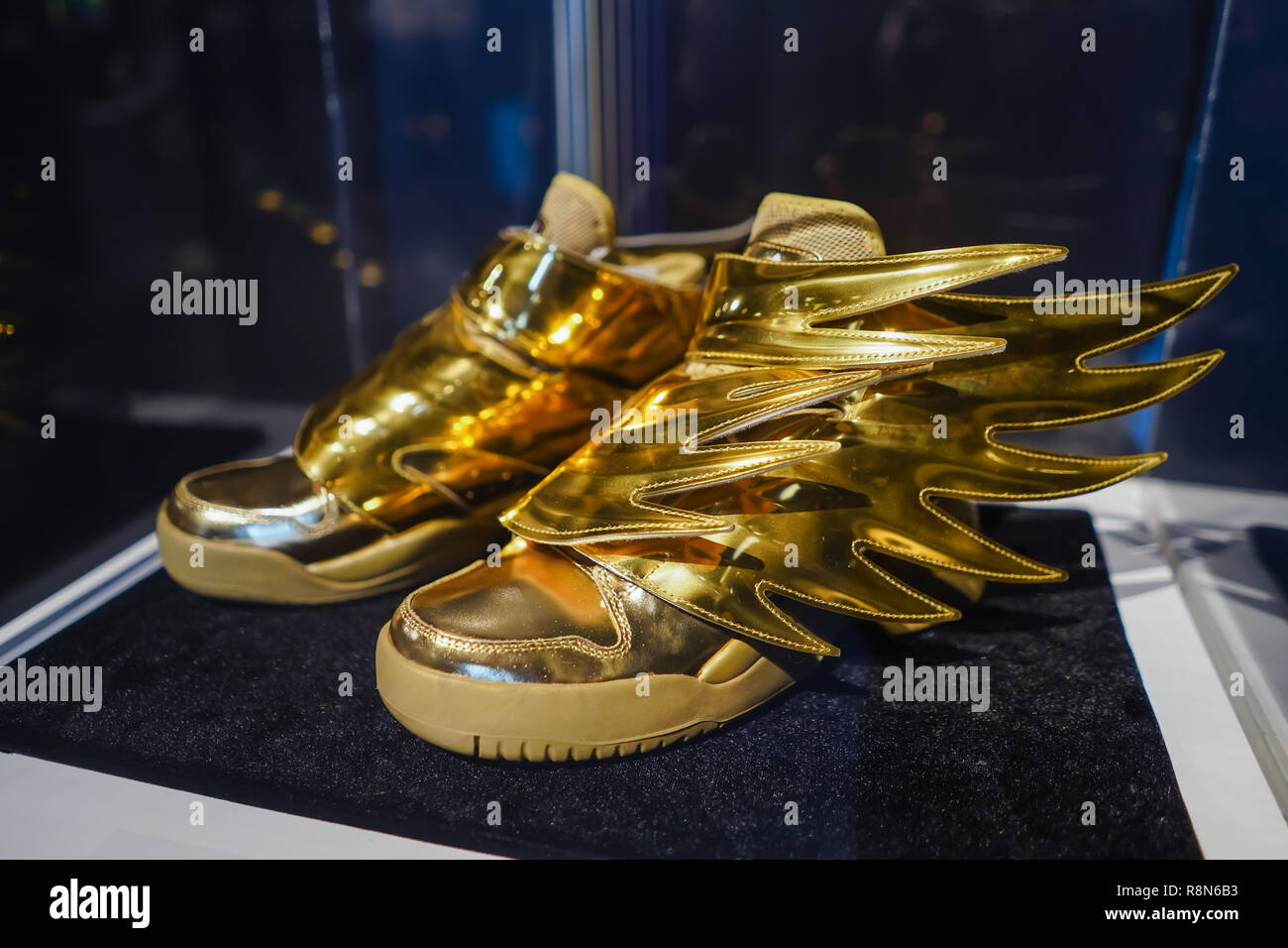 watch 6d59c b5d2b golden sneakers made for jeremy scott by adidas footwear company - Stock  Image