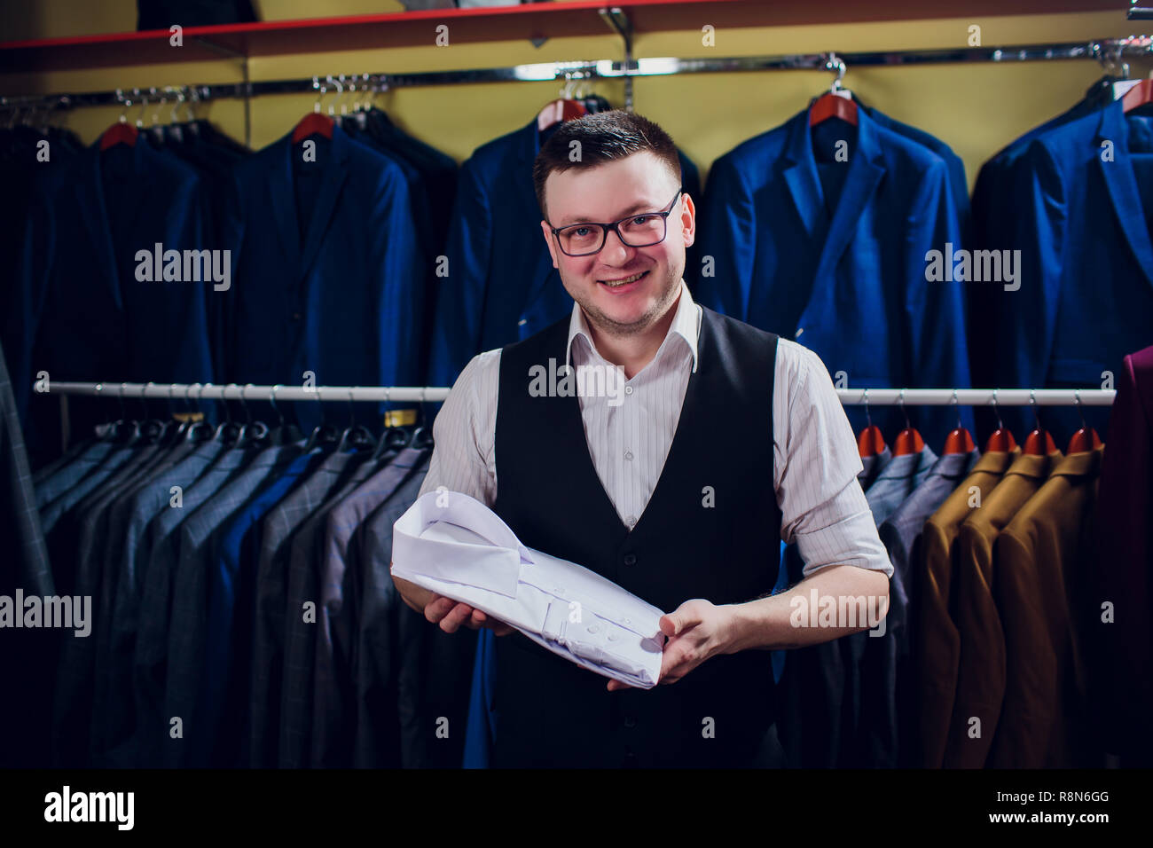 man is buying shirt in store - Stock Image