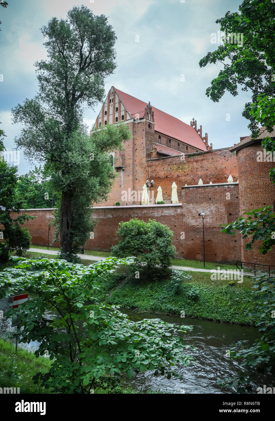 Ordensburg castle in Olsztyn, Poland. View from Lyna river. - Stock Image