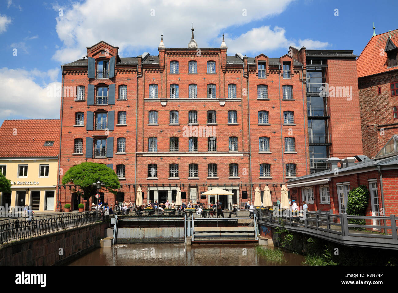 OLd watermill (Abtsmühle)in the old harbour quarter at river Ilmenau,  Lueneburg, Lüneburg,  Lower Saxony, Germany, Europe - Stock Image