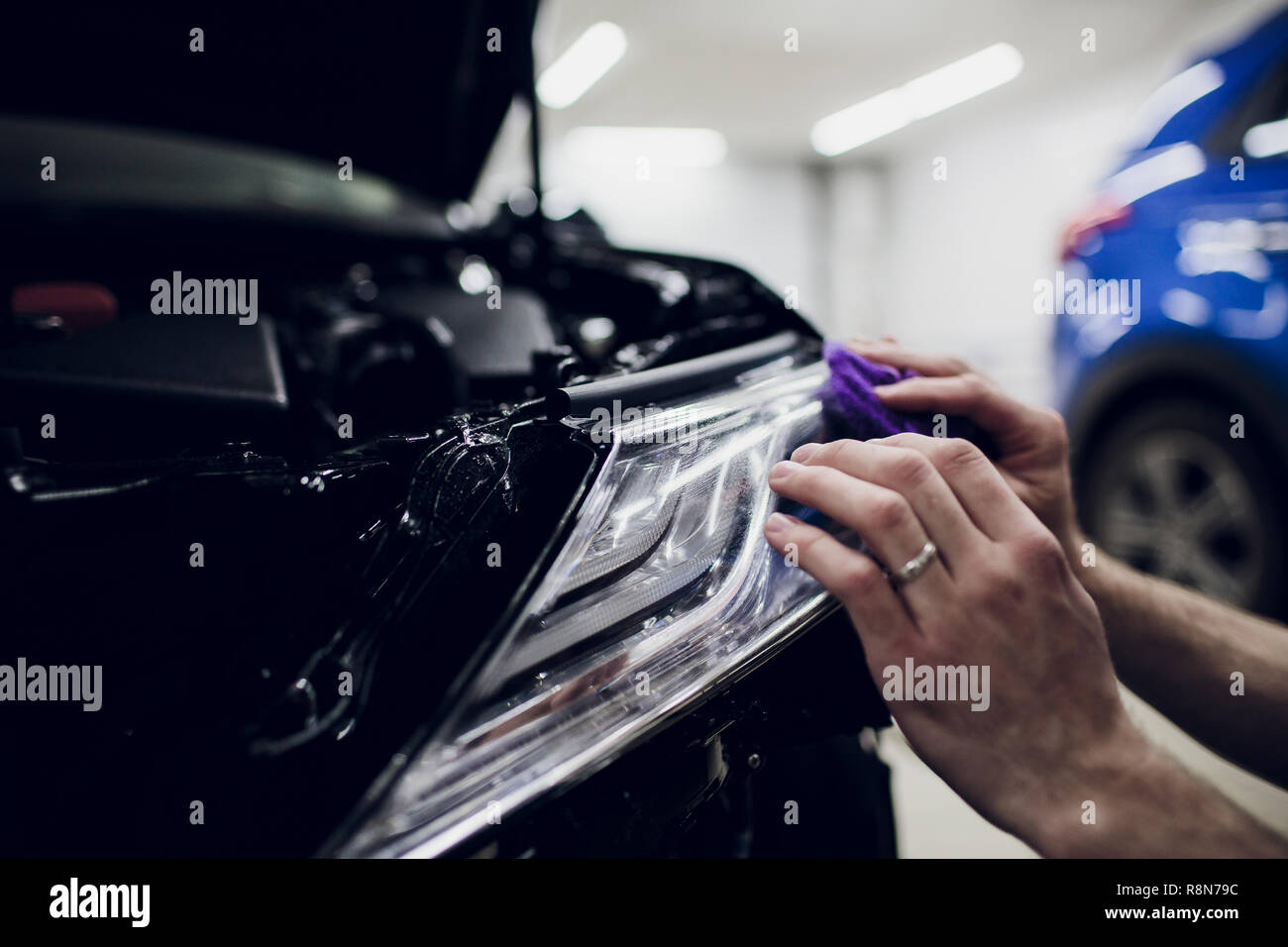 Worker Hands Installs Car Paint Protection Film Wrap Headlamp Stock