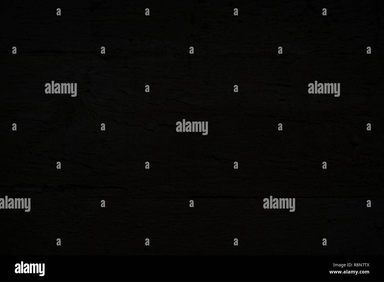 Close-up of dark gray, almost black, plastered concrete wall, texture background. Stock Photo