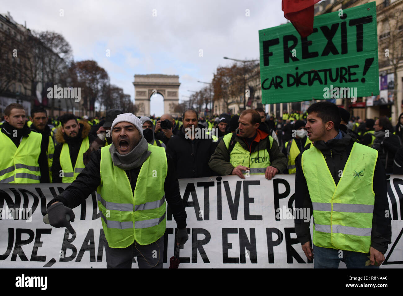 December 08, 2018 - Paris, France: Portrait of Farouk Largo (with a white beanie ), a Yellow Vest protester as he calls for a referendum against French President Emmanuel Macron.  Manifestation des Gilets Jaunes du 8 decembre a Paris, l'acte IV de leur mobilisation. *** FRANCE OUT / NO SALES TO FRENCH MEDIA *** - Stock Image