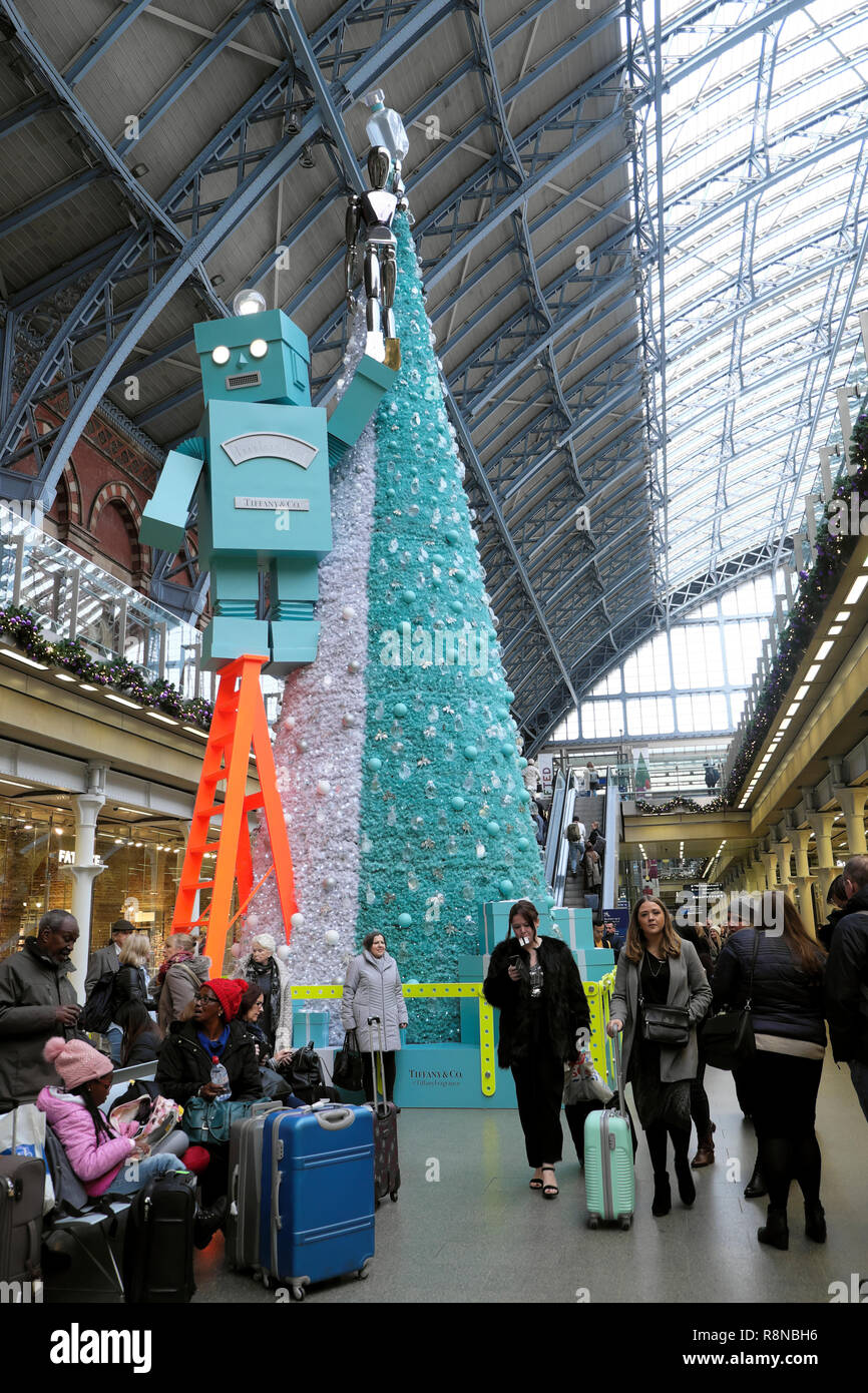 Tiffany & Co Christmas tree and robot and people in the shopping mall area at St Pancras International Railway Station in London UK  KATHY DEWITT Stock Photo