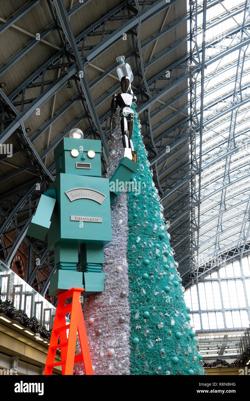 Tiffany & Co Christmas tree and robot in the shopping mall area at St Pancras International Railway Station in London UK  KATHY DEWITT Stock Photo