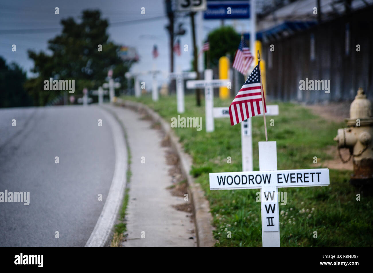 White crosses line New Peachtree Road in Doraville, Georgia, May 29, 2014. The crosses bear the names of the town's fallen war veterans. (Photo by Car - Stock Image