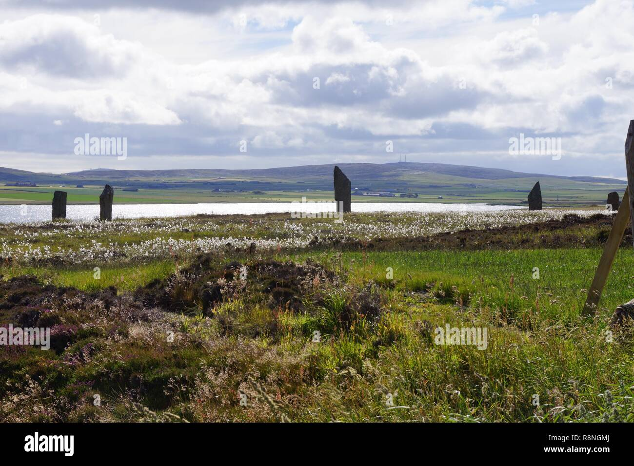 Skara Brae ancient village located on the Orkney Islands. On the way from Kirkwall we stopped at the standing stone called Ring of Brodgar. - Stock Image
