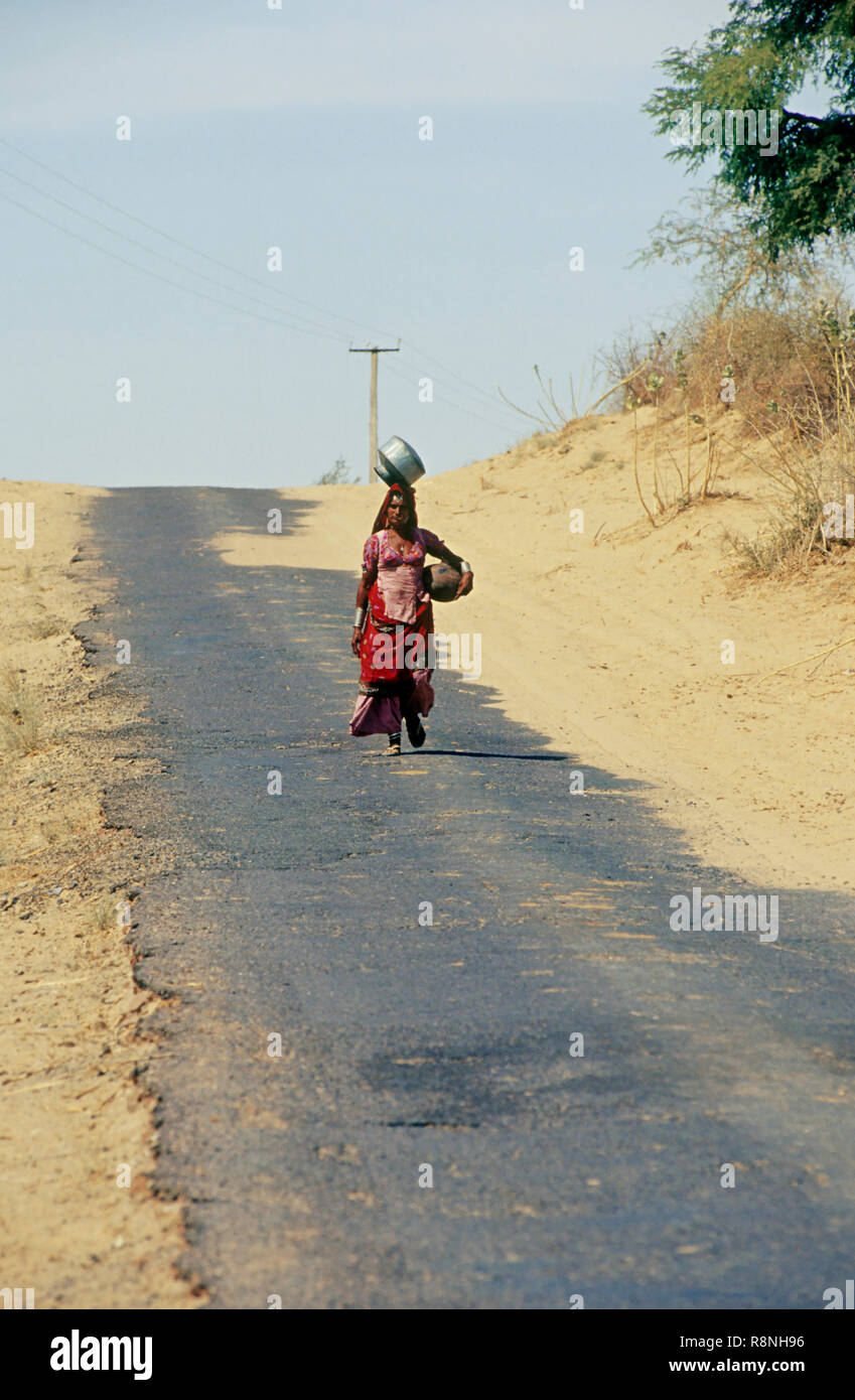 woman walking for miles everyday for water, rajasthan, india - Stock Image