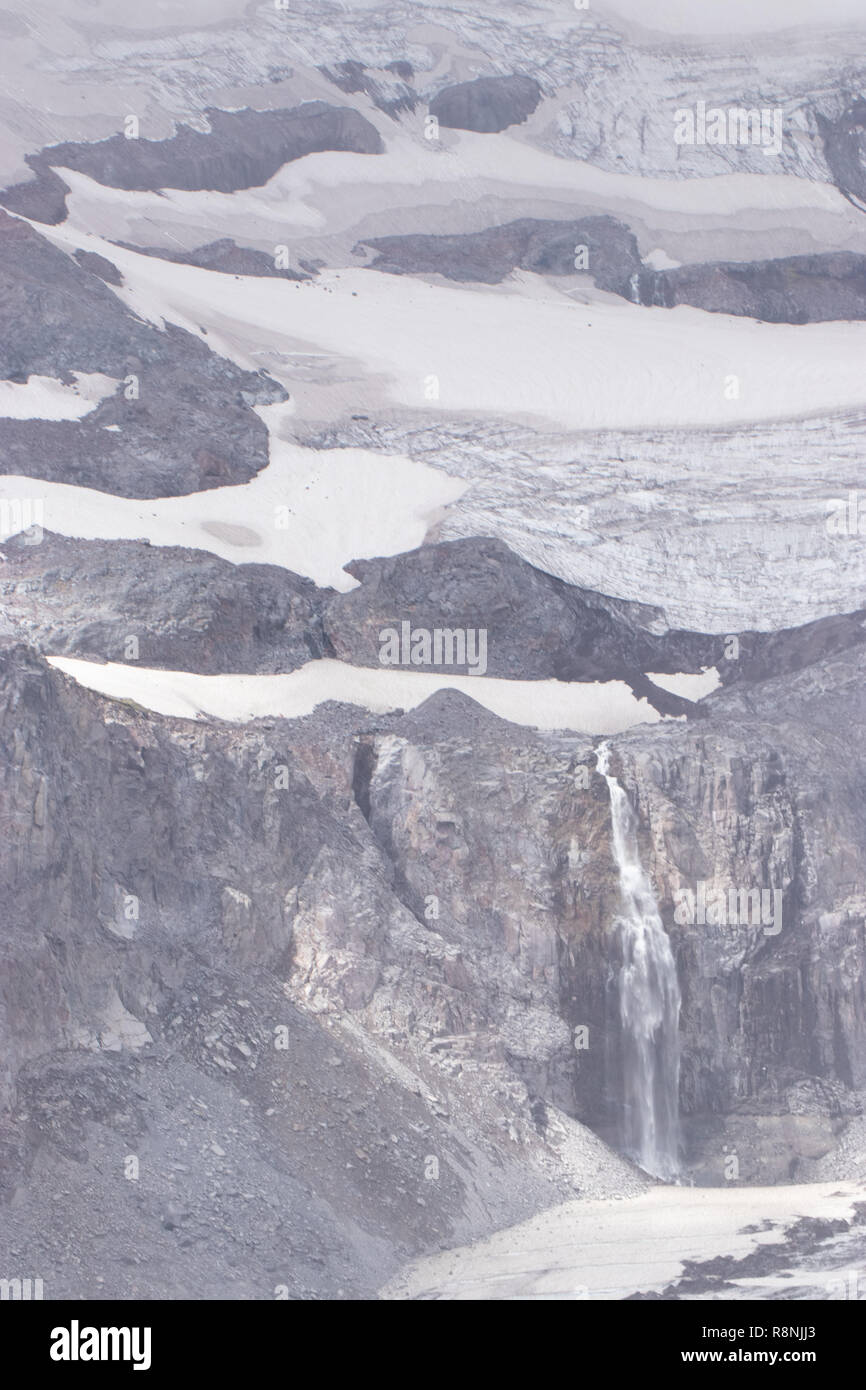 skyline trail view of waterfall and glaciers - Stock Image