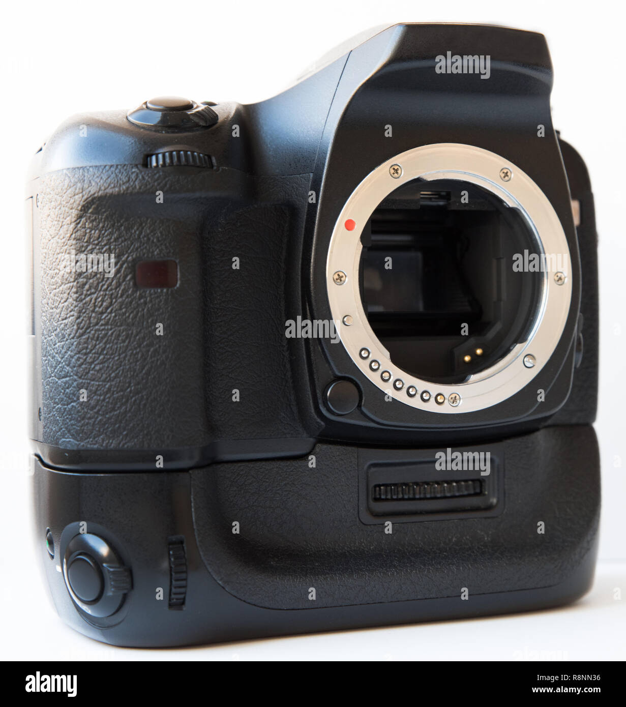 Digital SLR camera with lens and vertical battery grip isolated - Stock Image