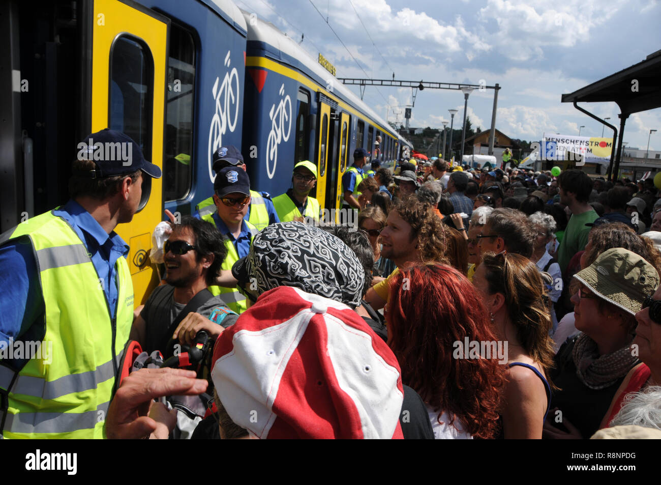 Thousands of people entering the SBB-trains in Döttingen after the anti nuclear protest in Beznau. - Stock Image