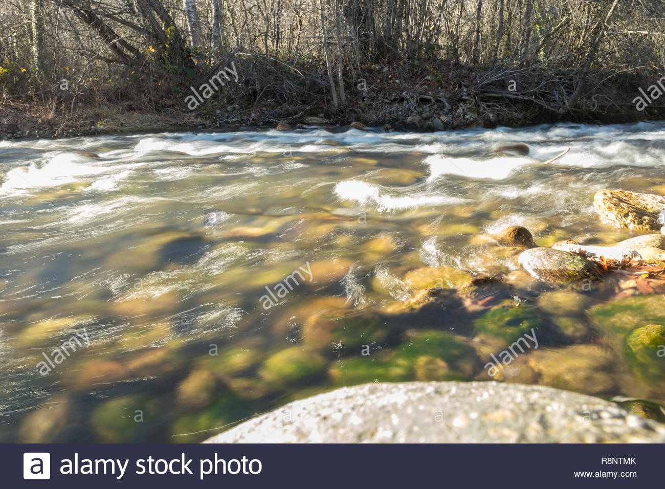 Long exposition photo of a river - Stock Image