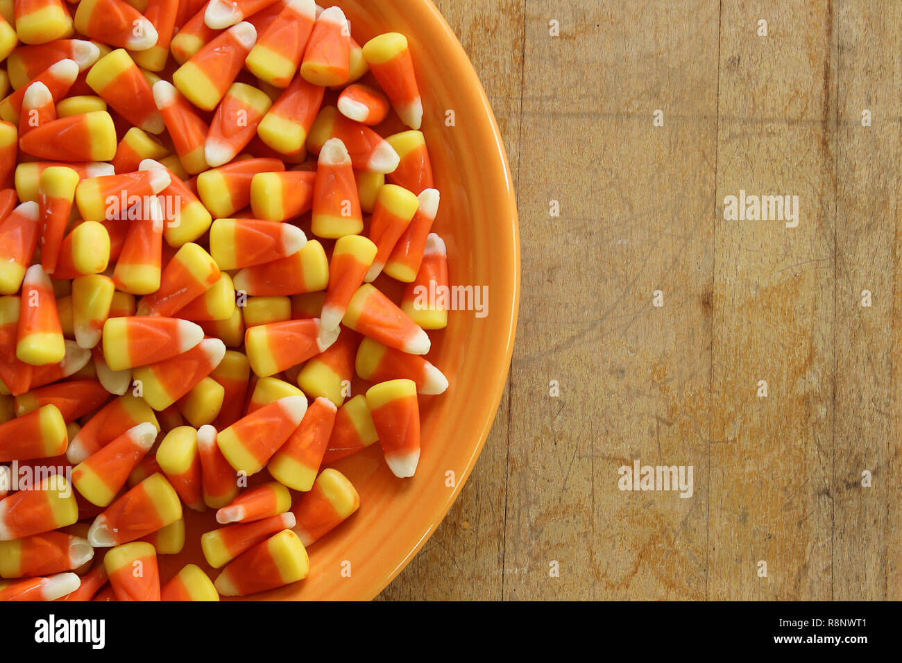 Bowl of Halloween candy corn. Copy space. - Stock Image