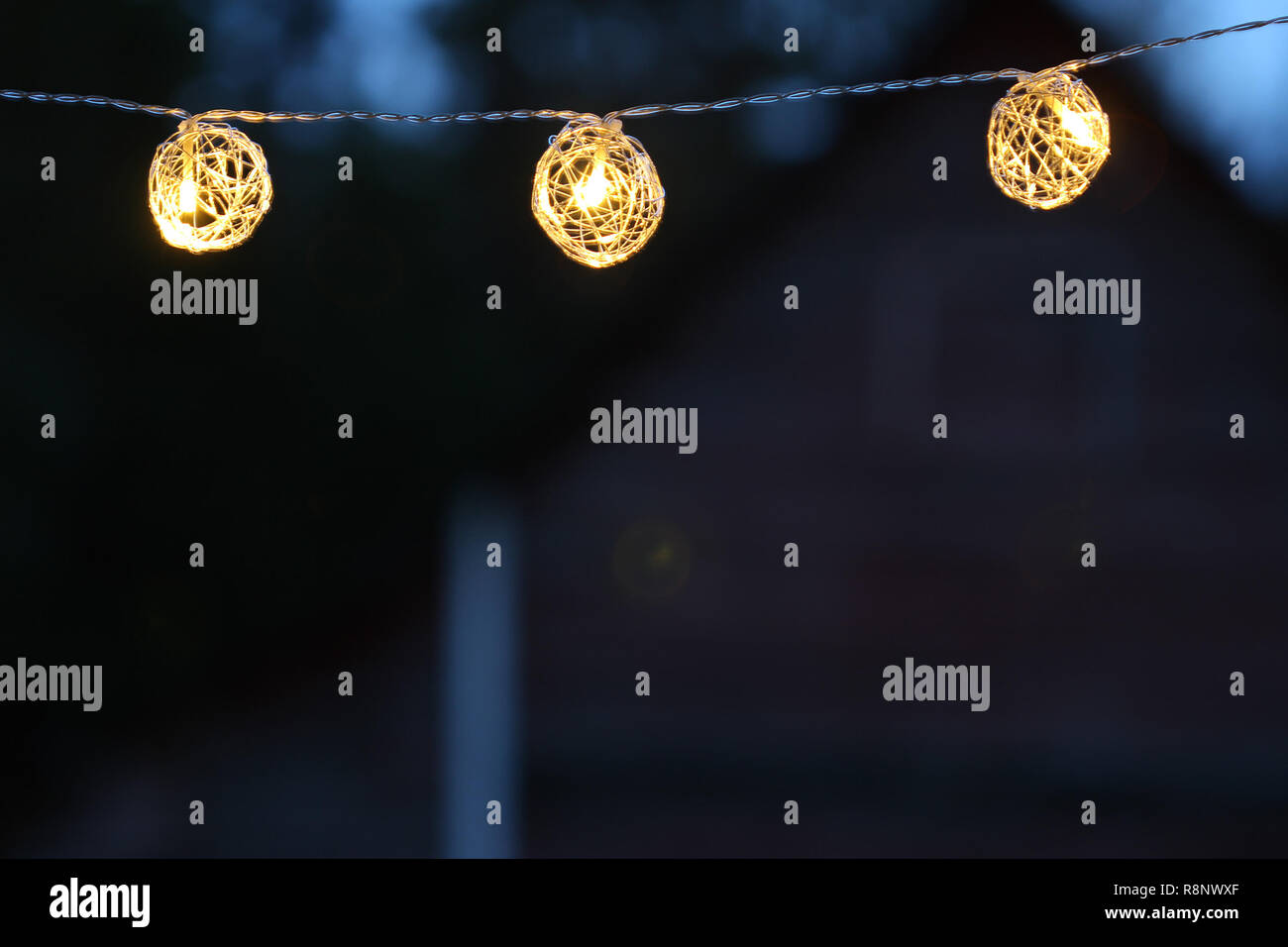 Night time string lights in the country. Copy space. - Stock Image