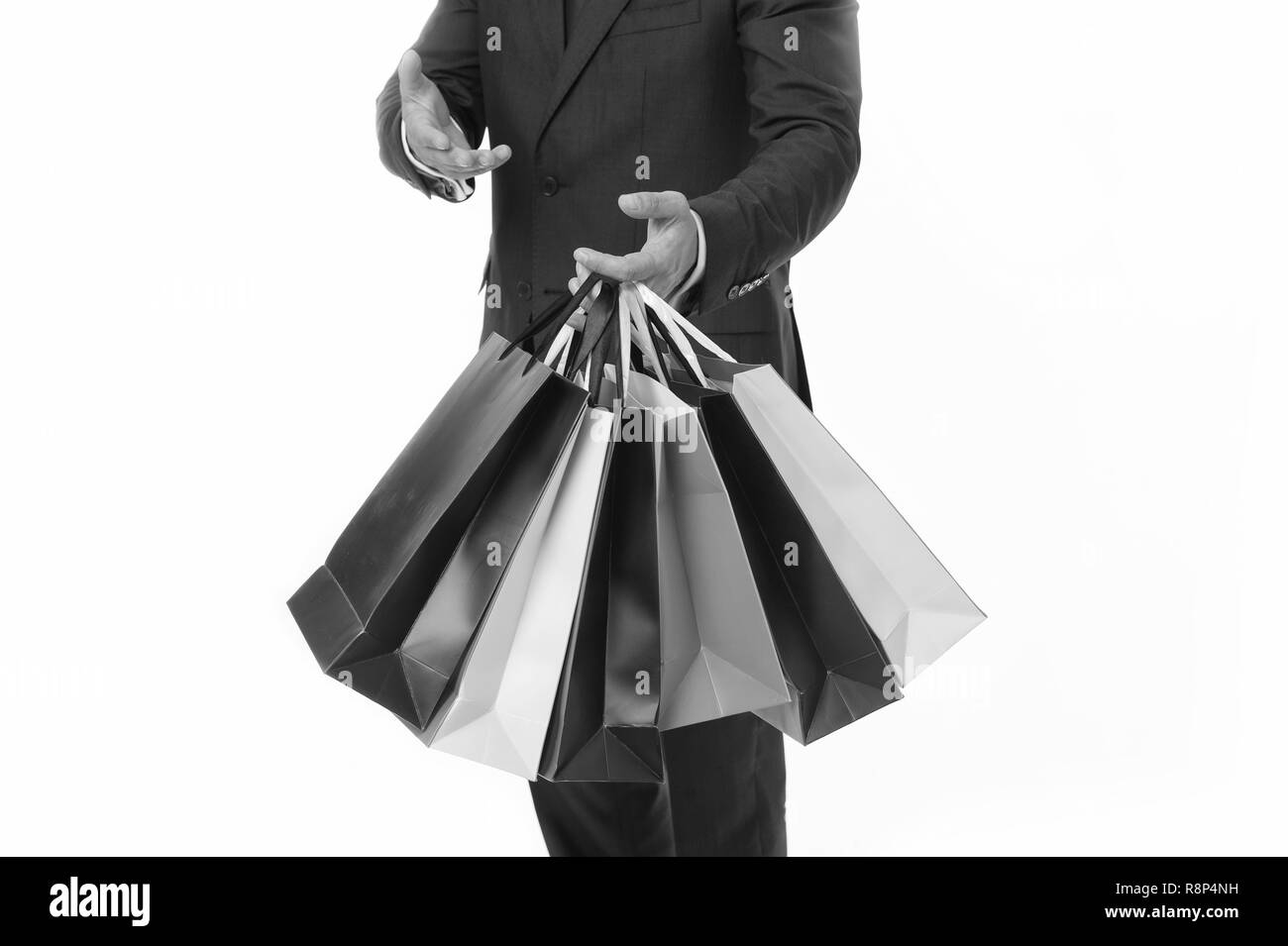 Recommend to buy. Hands of shopper carries shopping bags white background. Successful businessman choose only luxurious brands and shopping in high fashioned boutiques. Corporate discount sale. - Stock Image