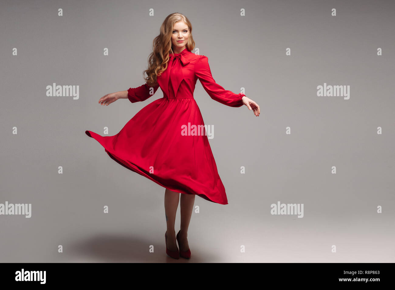 35692d827ea Stunning slim model in bright red dress and black heels Stock Photo ...