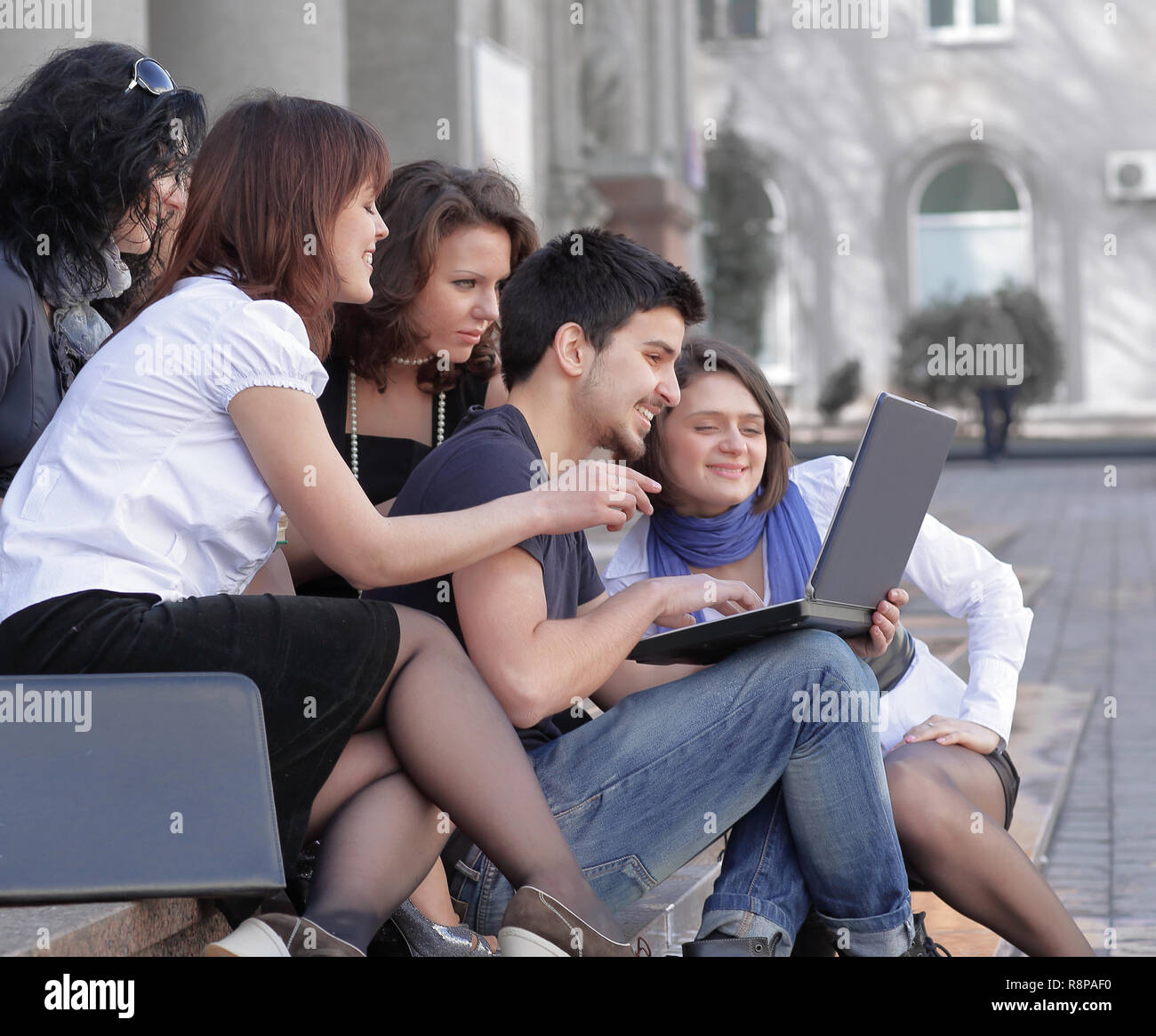group of fellow students with books and laptop - Stock Image