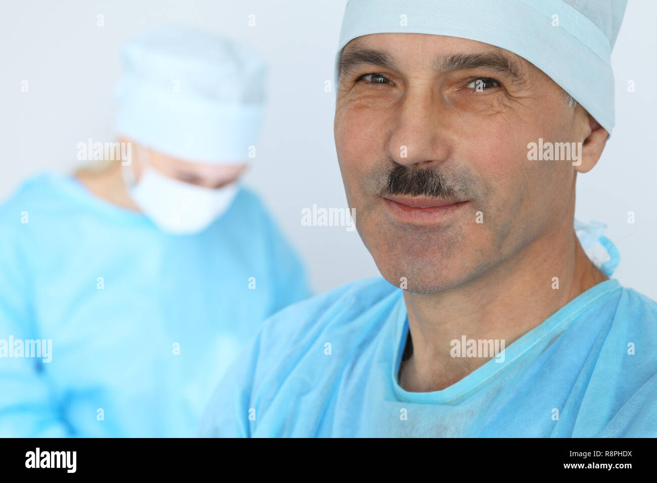 Boss surgeon is examining the operation while medical team are busy of patient. Medicine, healthcare and emergency in hospital - Stock Image