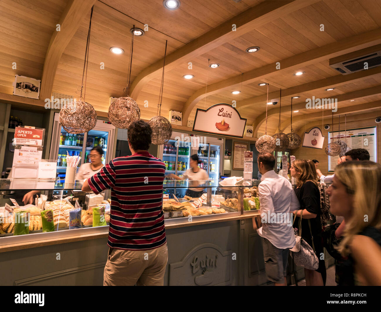 Horizontal view of people buying Panzerotti in Milan, Italy. - Stock Image