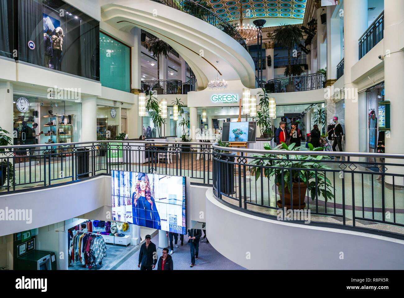 Canada, Quebec, Montreal, Les Cours Mont-Royal shopping mall in the former Mount Royal Hotel, once the largest hotel in the British Empire, interior Stock Photo