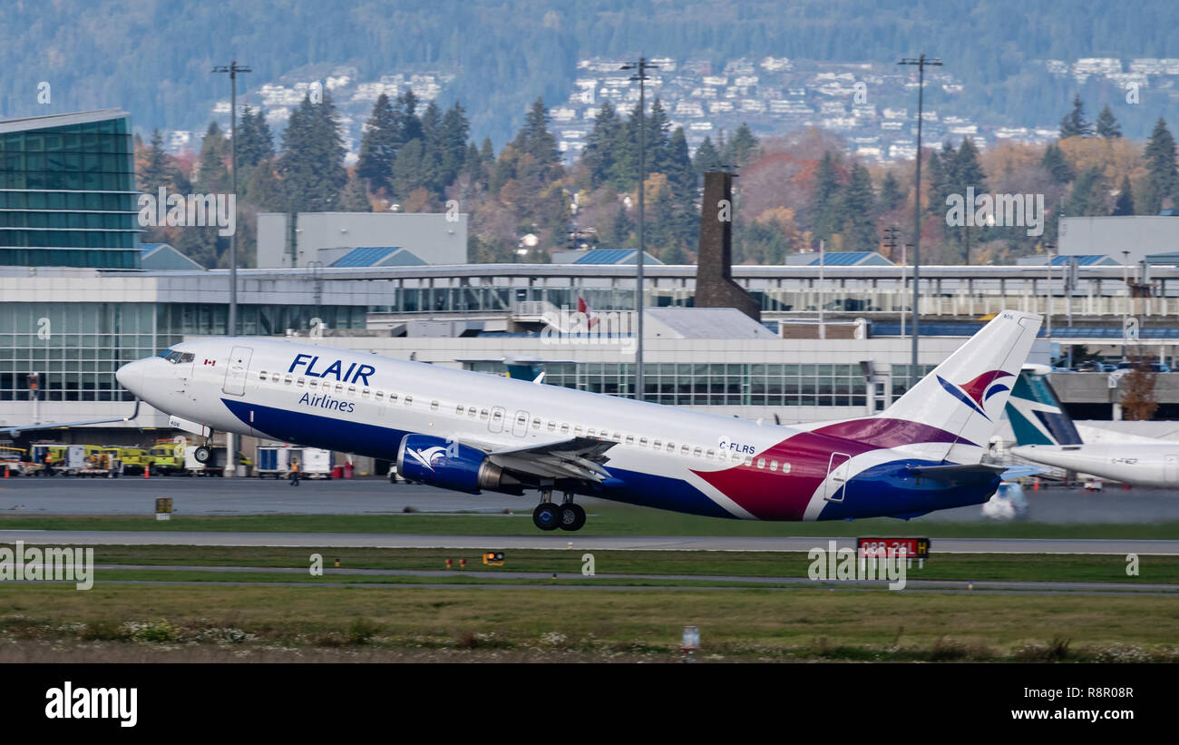 Flair Airlines plane Boeing 737 airplane jet airliner taking off - Stock Image