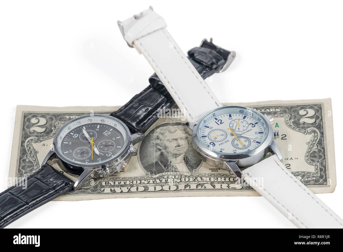 two wristwatches on a two-dollar bill, isolated on a white background - Stock Image