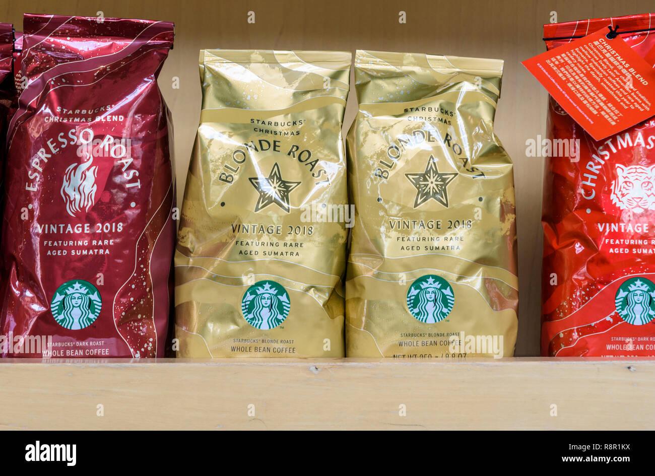 Starbucks Christmas coffee roast bags at a Starbucks - Stock Image