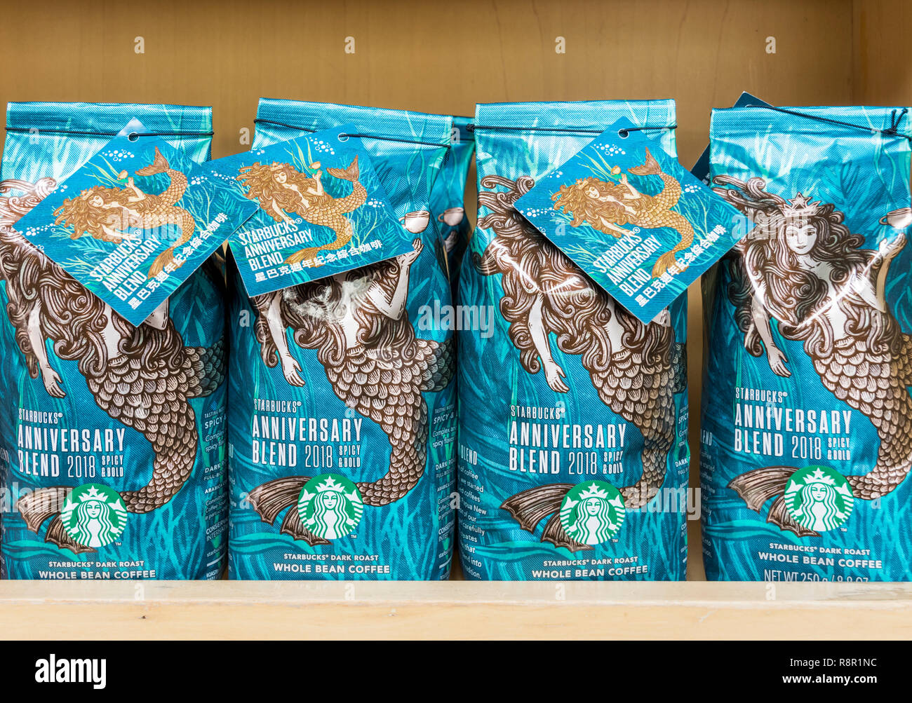 Starbucks anniversary blend coffee roast bags at a Starbucks - Stock Image