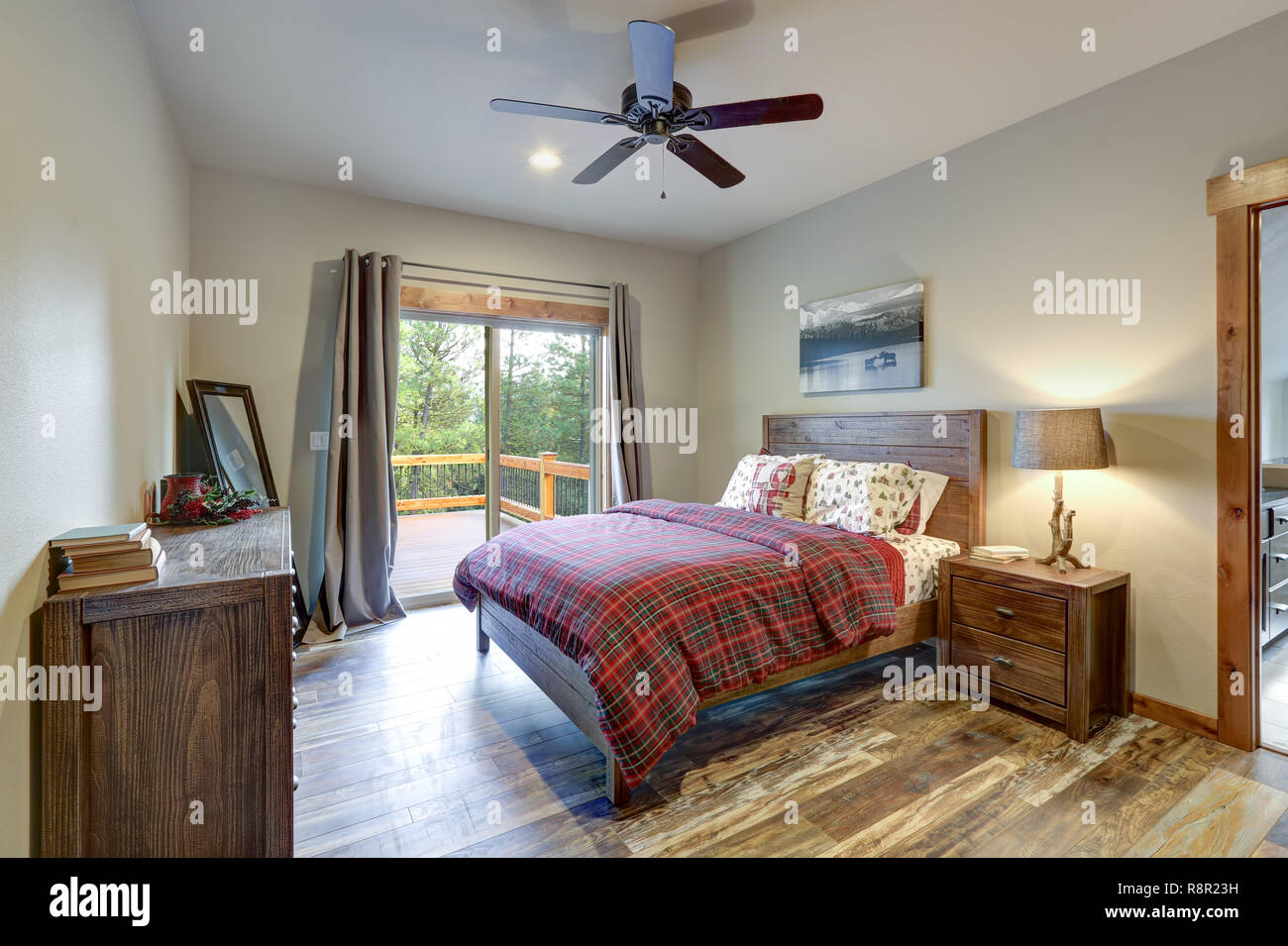 Restful country master bedroom furnished with wooden bed ...