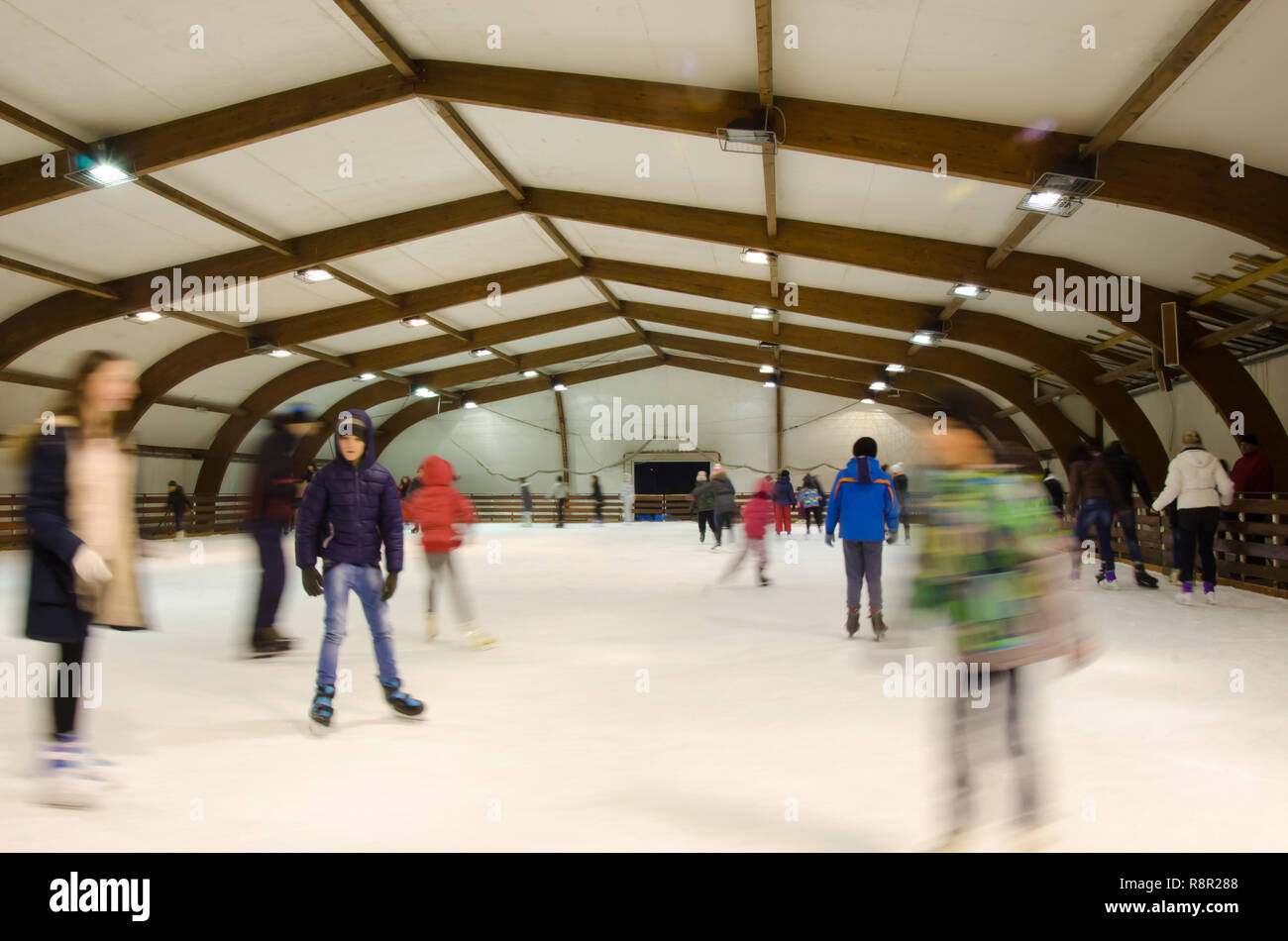Nis, Serbia, February 11, 2017:winter sport,indoor, blurred people on skating rink,motion, long exposure. People, friendship,sport and leisure concept - Stock Image