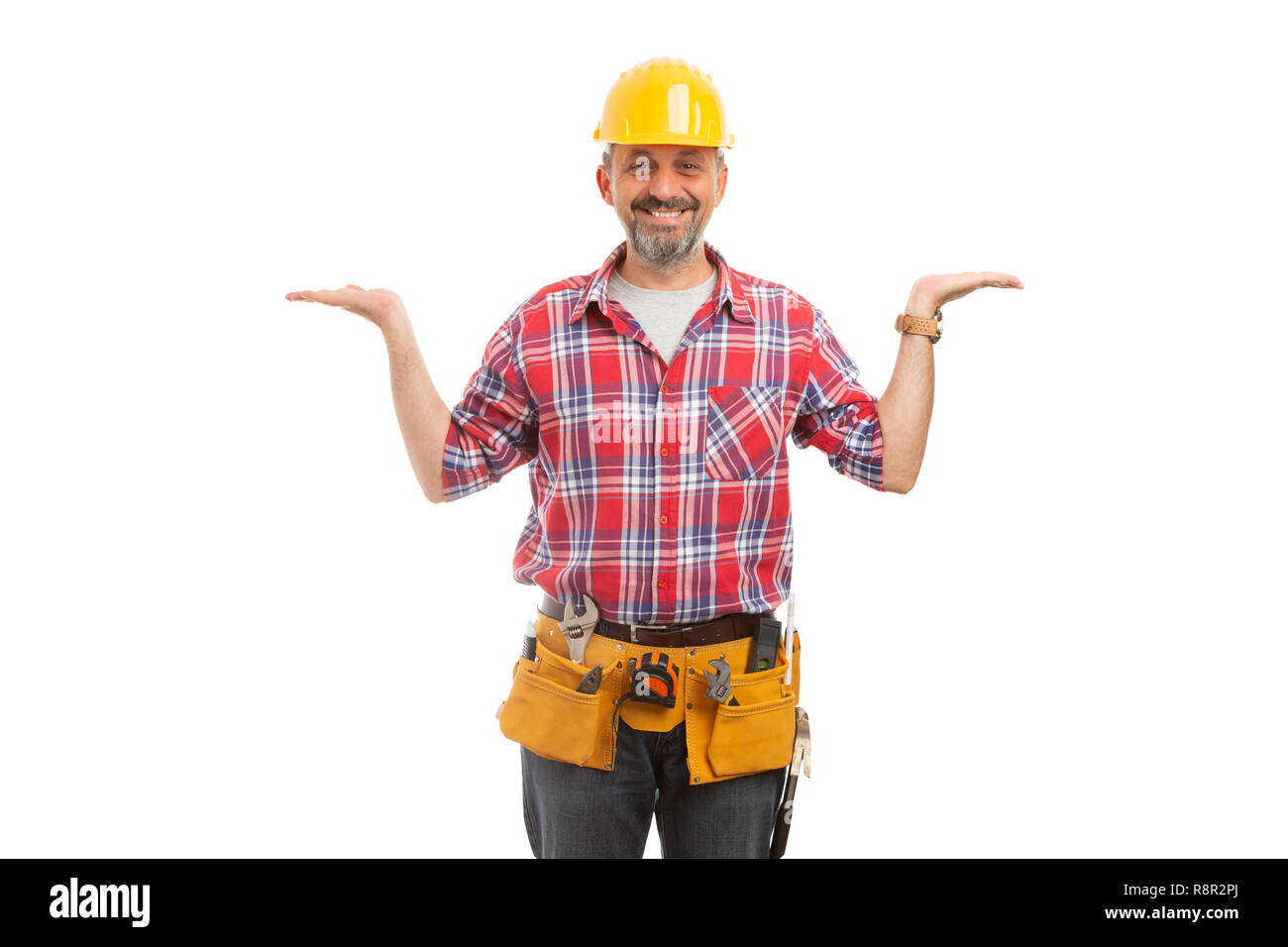 Friendly builder holding hands as blank copyspace for comparison and balance concept isolated on white background - Stock Image