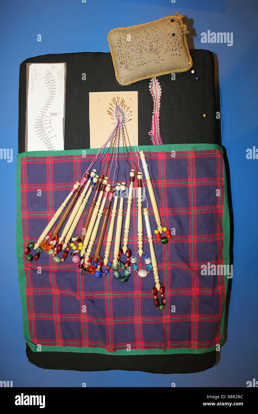 Bobbin Lace Made On A Pillow with Bobbins and Pins - Stock Image