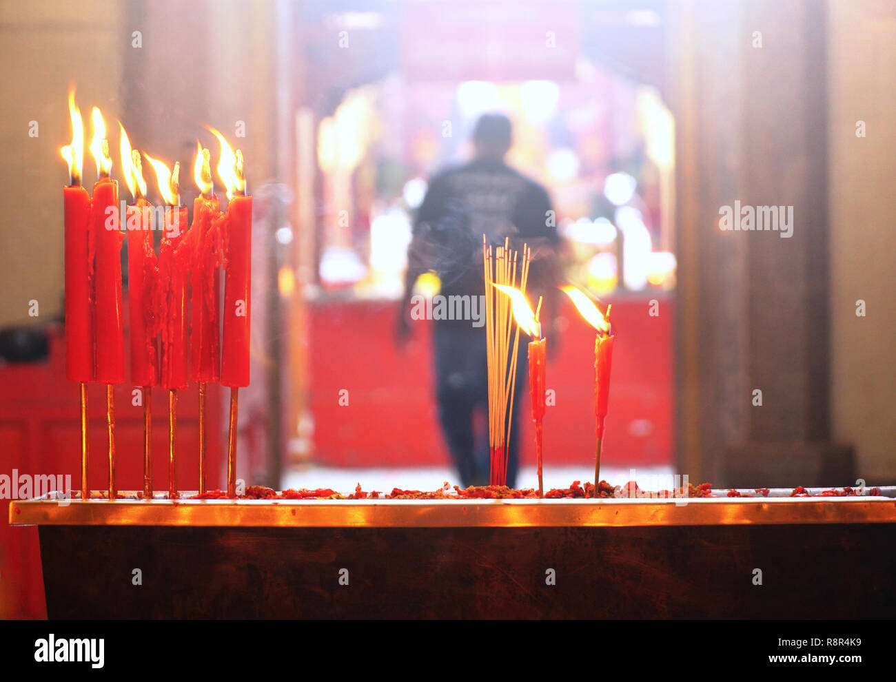 Candles and incenses in shrine temple in chinatown,chinese new year theme - Stock Image
