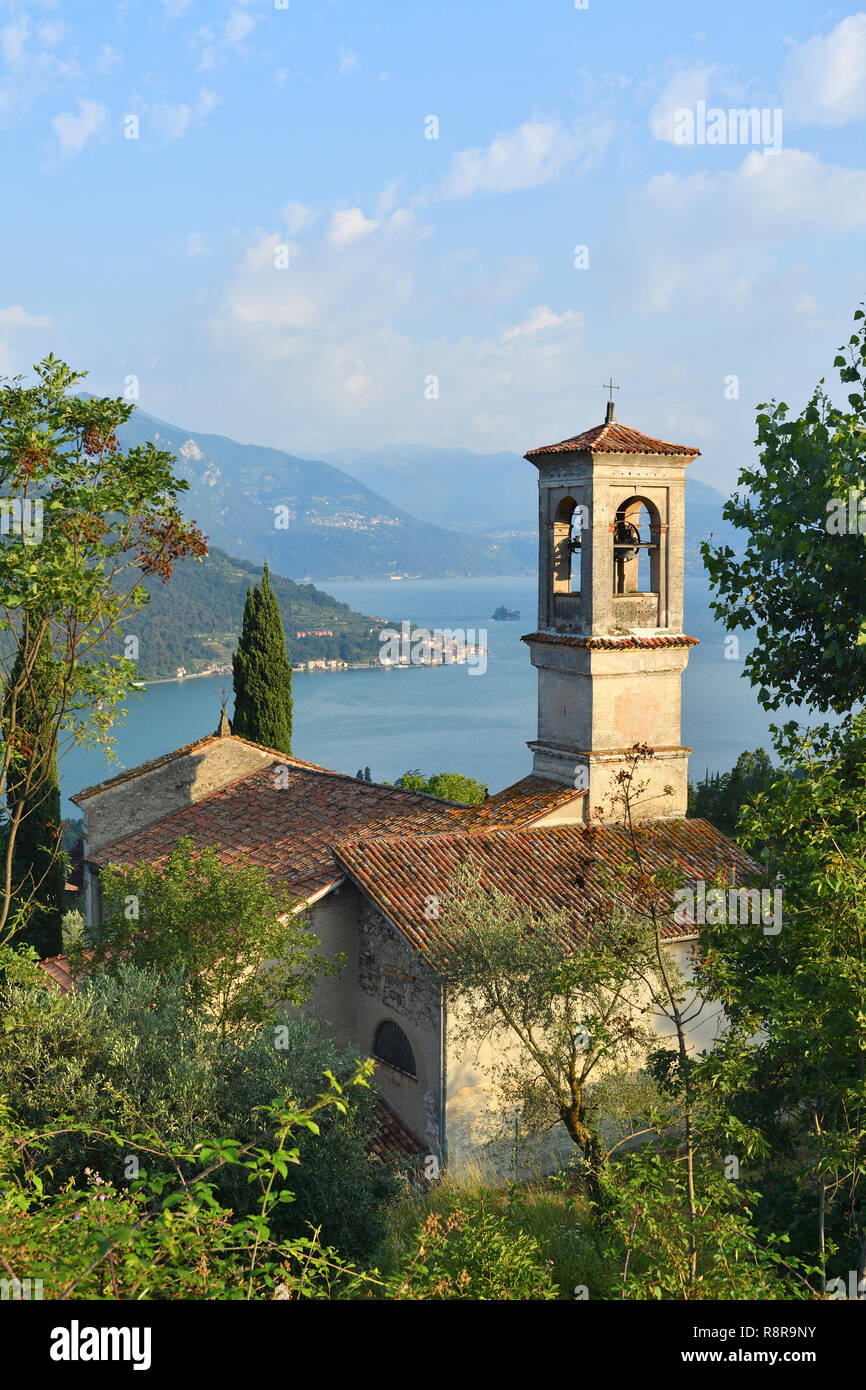 Italy, Lombardy, Iseo lake (Il Lago d'Iseo), the Church at Sale Marasino and Monte Isola island - Stock Image