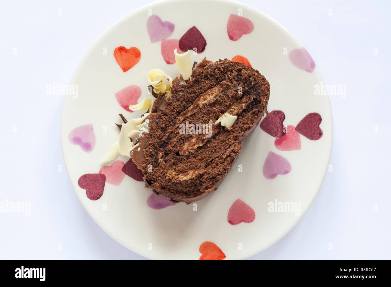 Slice of M&S Yuletide Log on plate - from above looking down on - Stock Image