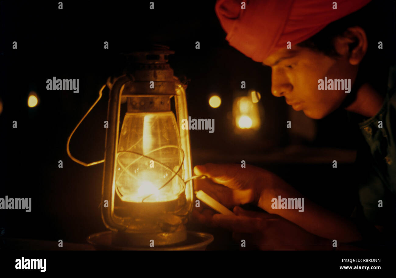 man holding candle and Lantern, gujarat, india, india - Stock Image