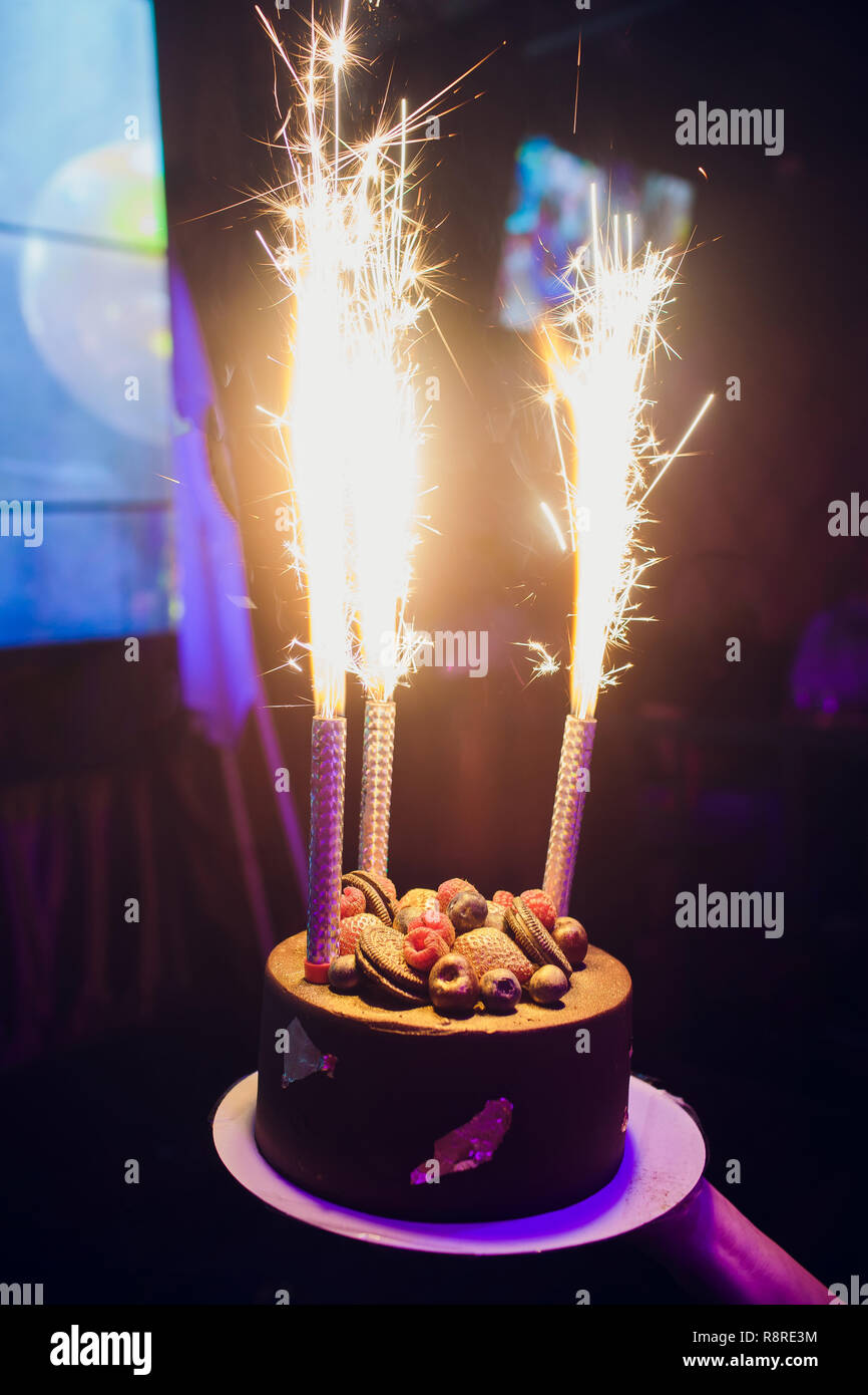 Sensational Birthday Cake With Fireworks On Table Stock Photo 229168008 Alamy Funny Birthday Cards Online Alyptdamsfinfo