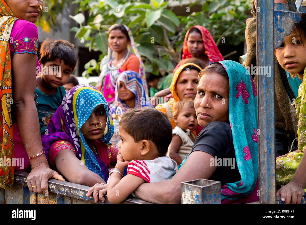 New delhi, India - 20 august 2018: children and women workers inside of truck after a day working at a construction site. Child labour is one of the m - Stock Image