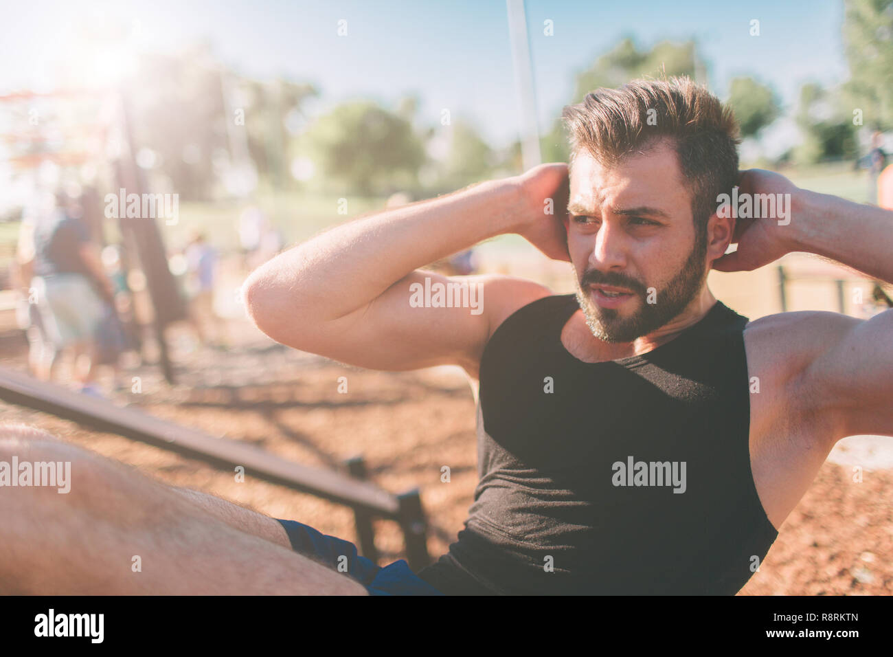 2f086b7c6b19 Muscular man exercising doing sit up exercise. Athlete with six pack
