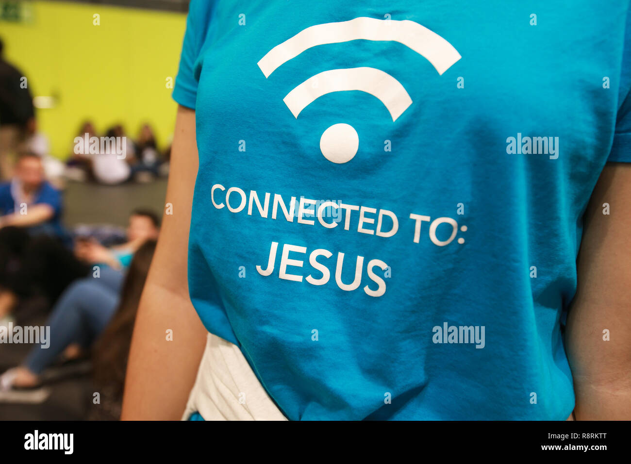 Connected to Jesus written on t-shirt. - Stock Image