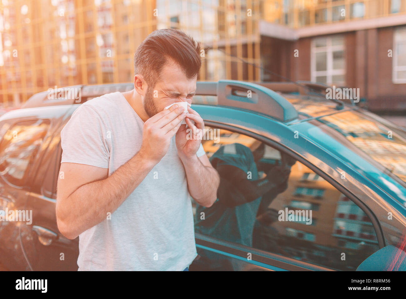 picture from a bearded man with handkerchief. Sick guy has runny nose. man makes a cure for the common cold - Stock Image