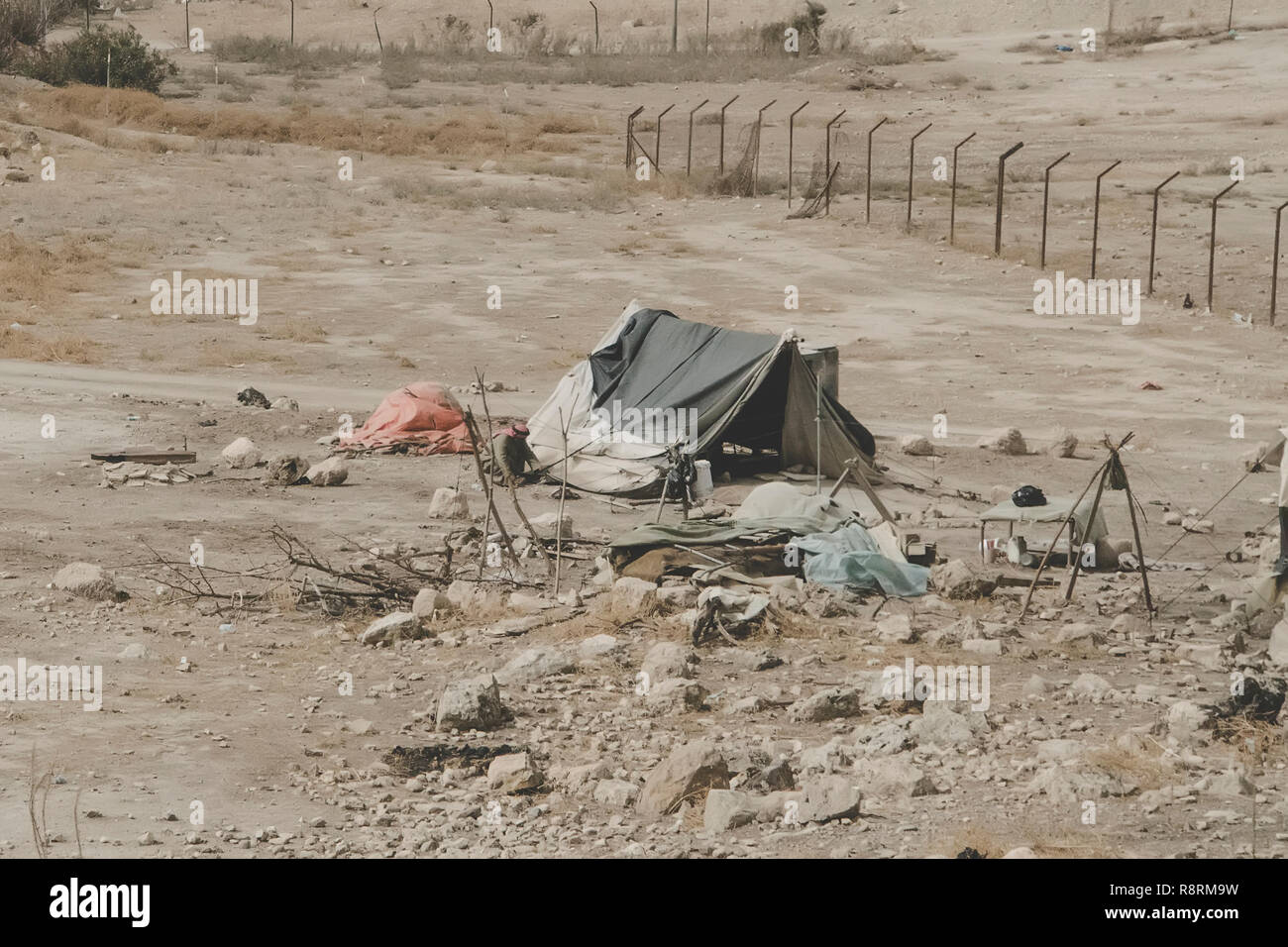 Bedouin houses in the desert near Dead Sea. Poor regions of the world. A indigent Bedouin sitting at the tent. Poverty in Jordan. middle East - Stock Image
