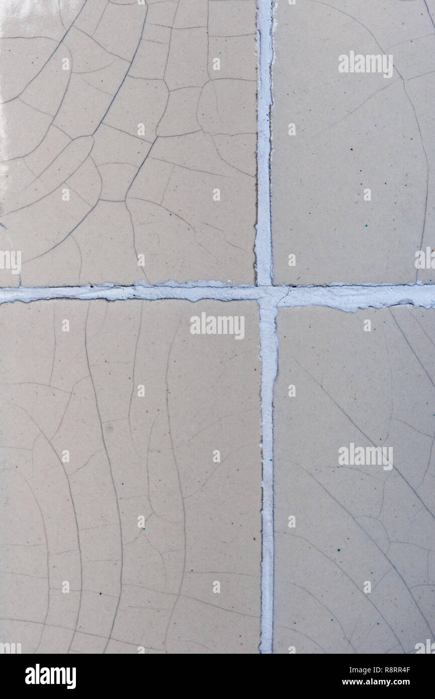 Crazed wall tiles with grouting. - Stock Image