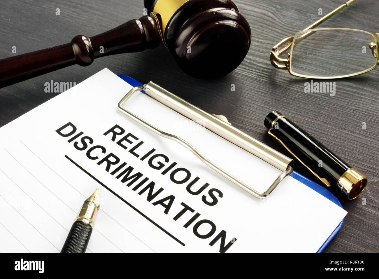 Religious Discrimination claim and pen on a table. - Stock Image