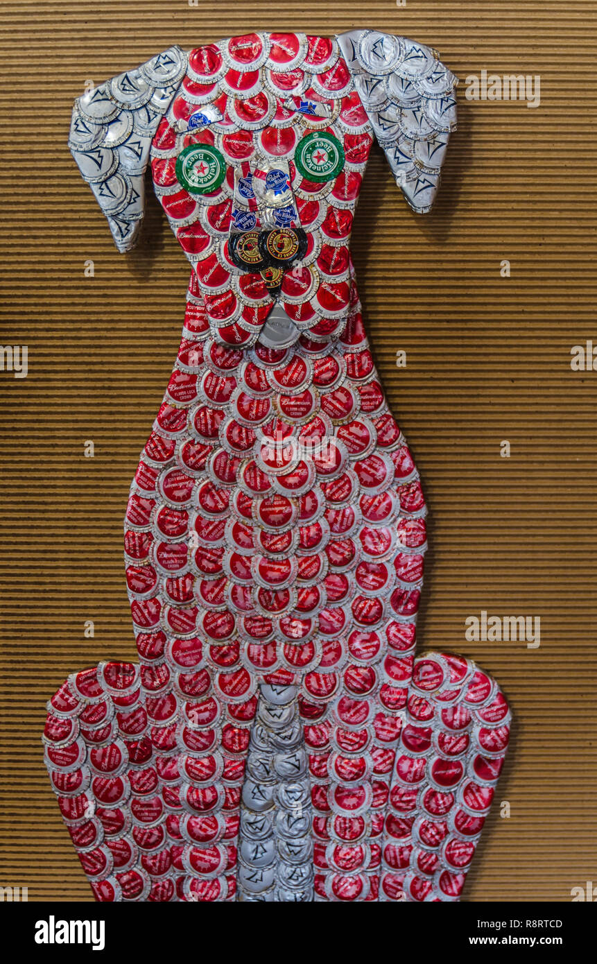 A piece of art constructed from bottle caps hangs on the wall at Mississippi Gift Company in Greenwood, Mississippi. - Stock Image