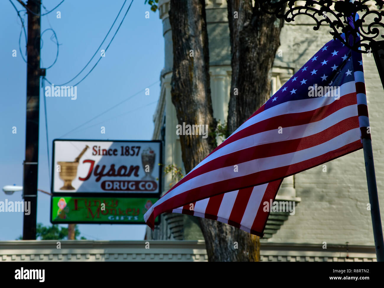 An American flag flies Sept. 25, 2011 in Holly Springs, Miss. In the background is Tyson Drug Co., which sells old-fashioned sodas and milkshakes. - Stock Image